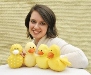 Jessica George - our stitched pattern designer - with a selection of the ducks she has made